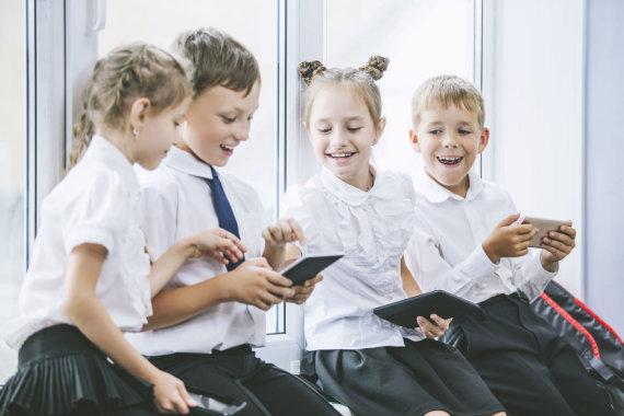 123RF.com nuotr./Vaikai per pertrauką mokykloje