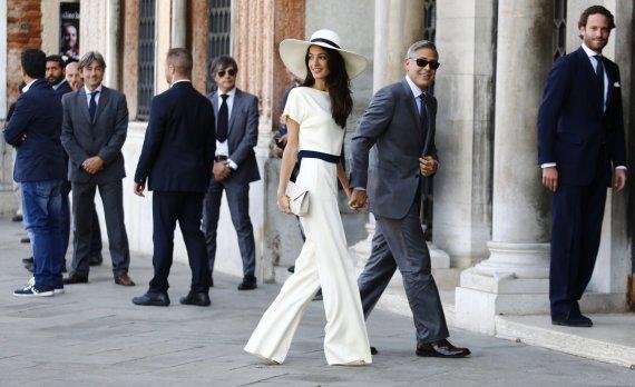 """AFP/""""Scanpix"""" nuotr./George'as Clooney ir Amal Clooney"""