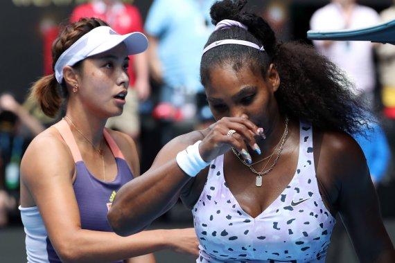 "AFP/""Scanpix"" nuotr./Qiang Wang ir Serena Williams"