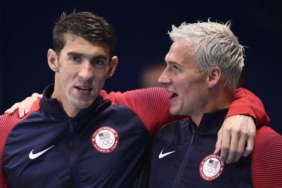 """""""Scanpix"""" nuotr./Michaelas Phelpsas ir Ryanas Lochte"""