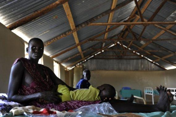 """AFP/""""Scanpix"""" nuotr./Nuo maliarijos miršta beveik du kartus daugiau žmonių nei manyta anksčiau"""