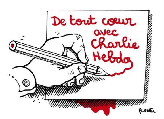 """Nuotr. iš """"Twitter""""/Socialiniuose tinkluose plinta šis solidarumo gestas: """"Visų širdys su """"Charlie Hebdo"""""""
