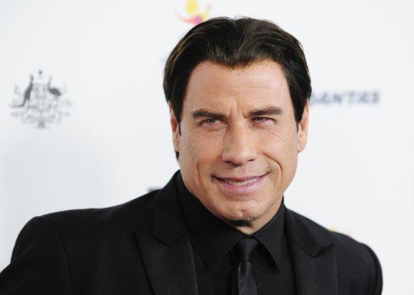 """""""Reuters""""/""""Scanpix"""" nuotr./Johnas Travolta švenčia 60-ąjį gimtadienį"""