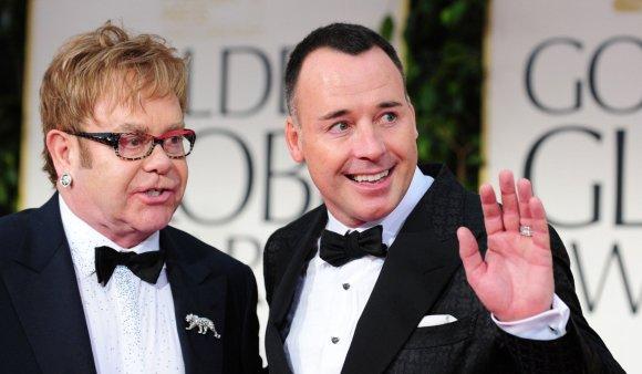"""AFP/""""Scanpix"""" nuotr./Eltonas Johnas ir Davidas Furnishas"""