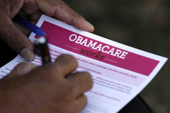 """""""Reuters""""/""""Scanpix"""" nuotr./Daug amerikiečių iki šiol teigia nepritariantys vadinamajam """"Obamacare"""" įstatymui"""