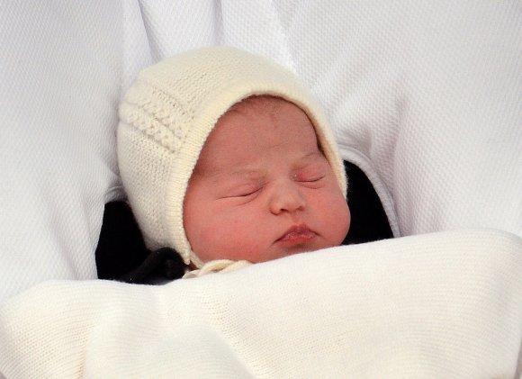 """AFP/""""Scanpix"""" nuotr./Kembridžo hercogienės Catherine ir princo Williamo dukra"""