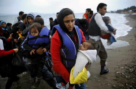 """""""Reuters""""/""""Scanpix"""" nuotr./Graikijos Koso saloje išsilaipinę pabėgeliai iš Afganistano ir Sirijos"""