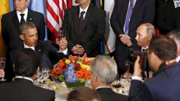 """""""Reuters""""/""""Scanpix"""" nuotr./Barackas Obama ir Vladimiras Putinas"""