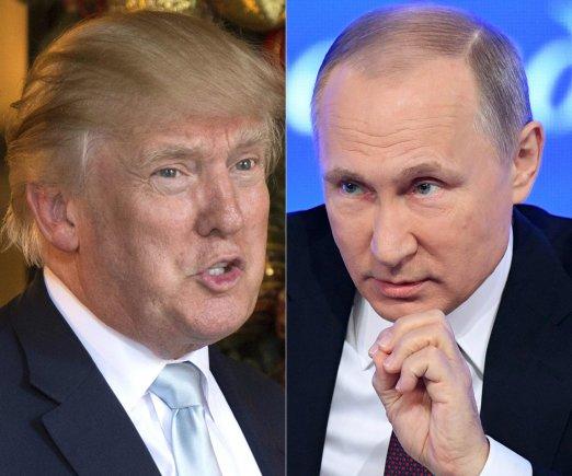 """AFP/""""Scanpix"""" nuotr./D.Trumpas ir V.Putinas."""