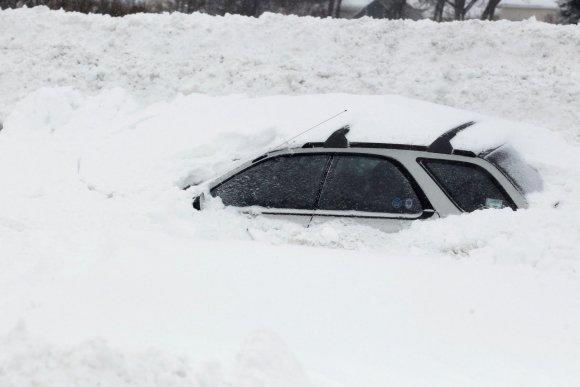 """""""Reuters""""/""""Scanpix"""" nuotr./Automobilis sniege"""