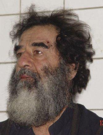 """""""Reuters""""/""""Scanpix"""" nuotr./Sulaikytas Saddamas Husseinas (2003 m. gruožio 14 d.)"""