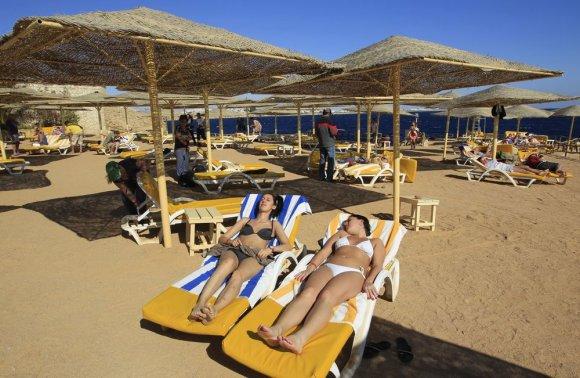 """AFP/""""Scanpix"""" nuotr./Kur spalį surasti saulės?"""