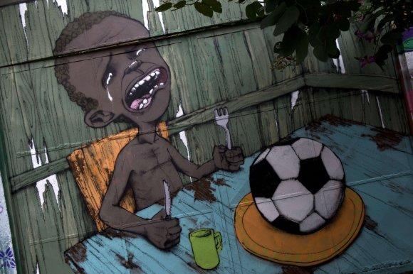 """AFP/""""Scanpix"""" nuotr./Piešinys Brazilijoje"""