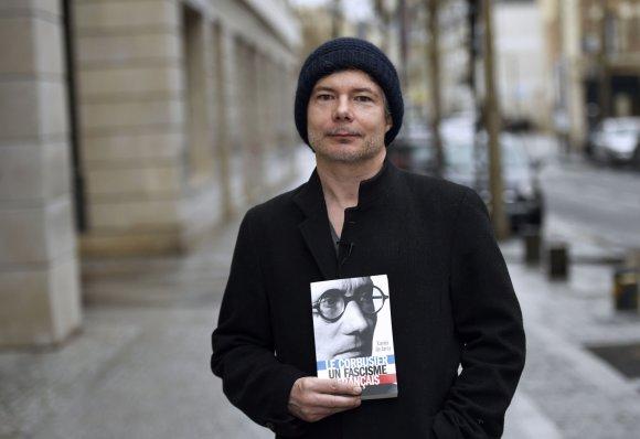 """AFP/""""Scanpix"""" nuotr./Žurnalistas Xavieras de Jarcy"""