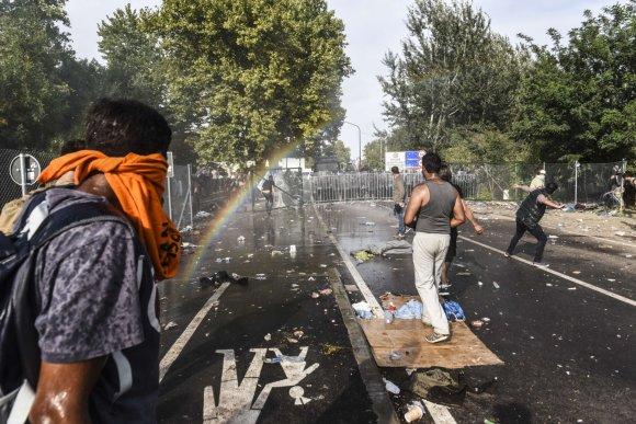 """AFP/""""Scanpix"""" nuotr./Migrantų keliami neramumai Vengrijoje"""