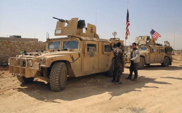 """""""Scanpix""""/AP nuotr./Į Siriją iš Irako atvyko JAV elitinio 75-ojo reindžerių pulko kariai"""