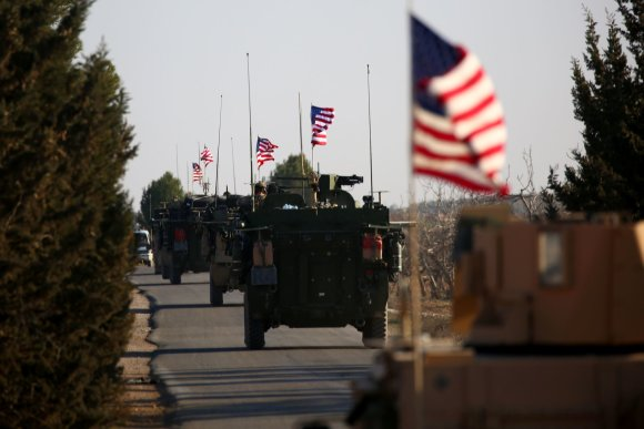 """AFP/""""Scanpix"""" nuotr./Į Siriją iš Irako atvyko JAV elitinio 75-ojo reindžerių pulko kariai"""
