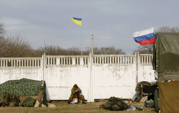 """""""Reuters""""/""""Scanpix"""" nuotr./Ukrainos kariai rusų specialiosioms pajėgoms Kryme nesipriešino"""
