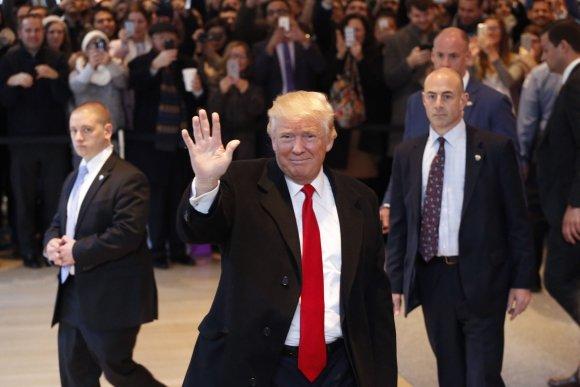 """""""Scanpix""""/AP nuotr./Donaldas Trumpas dienraščio """"The New York Times"""" redakcijoje"""