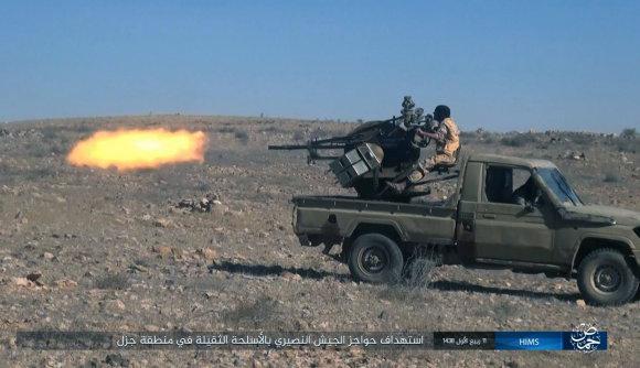 """""""Scanpix""""/AP nuotr./""""Islamo valstybės"""" kovotojai toliau siautėja Sirijoje"""