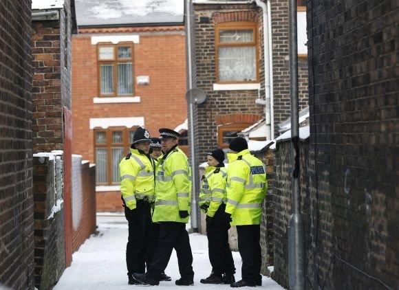 """""""Reuters""""/""""Scanpix"""" nuotr./Britų policininkai"""