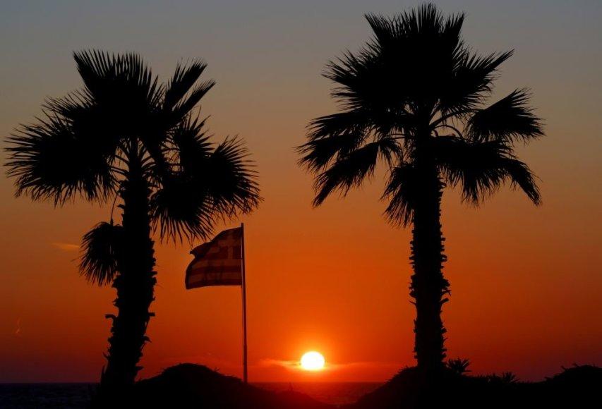 Graikijos vėliava saulei leidžiantis