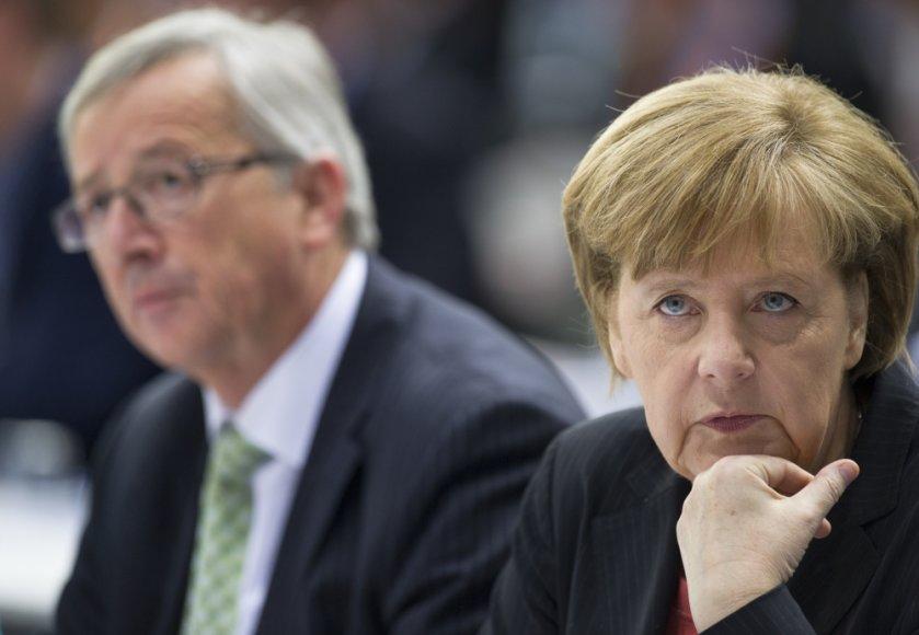 Jeanas-Claudeas Junckeris ir Angela Merkel