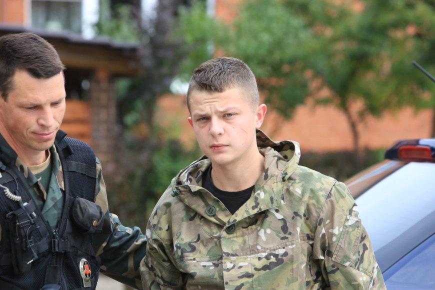 Rusijos pareigūnas atvesdintas į teismą