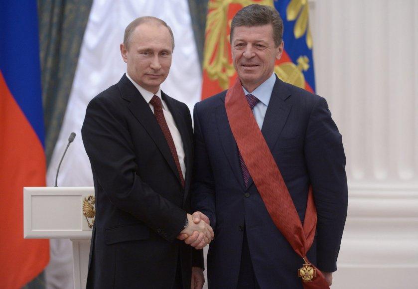 V.Putinas sveikina D,Kozaką.