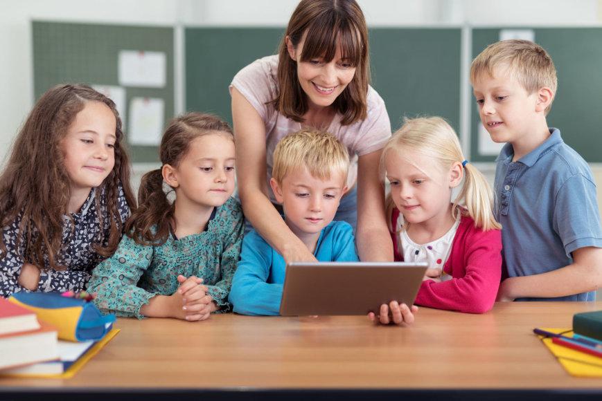 Mokiniai ir mokytoja