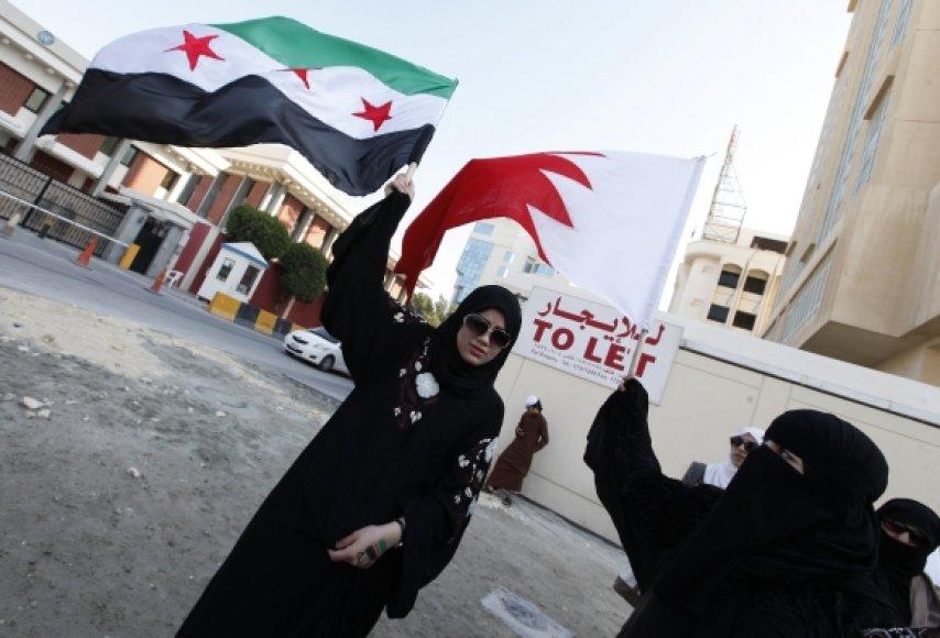 Protestuotojos Sirijoje penktadienį.