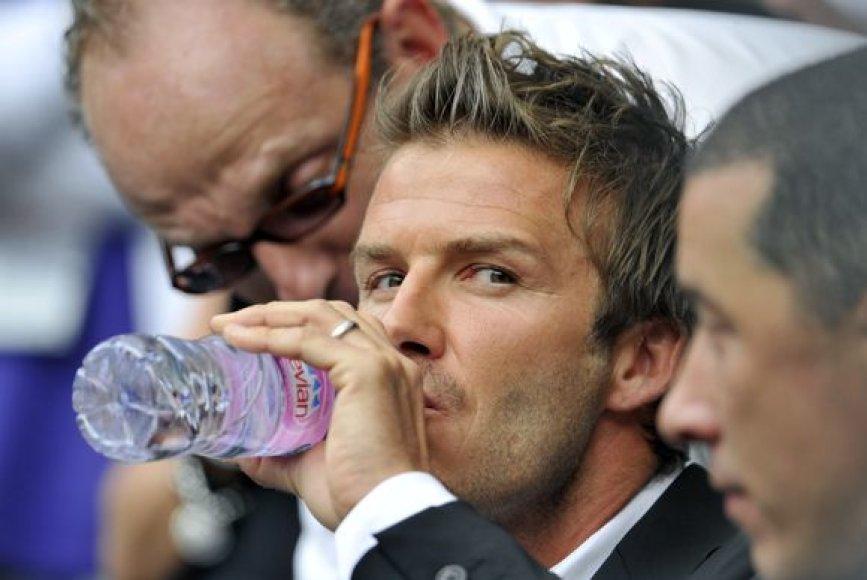 Davidas Beckhamas su sūnumi Brooklynu stebi dvikovą tarp ispano Rafaelio Nadalio ir brito Andy Murray'aus.
