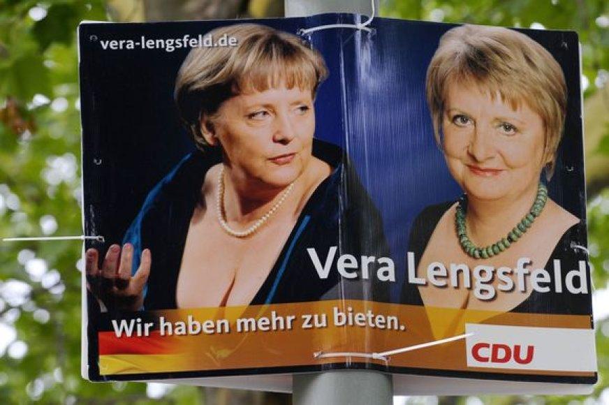 Garsusis plakatas su A.Merkel iškirpte