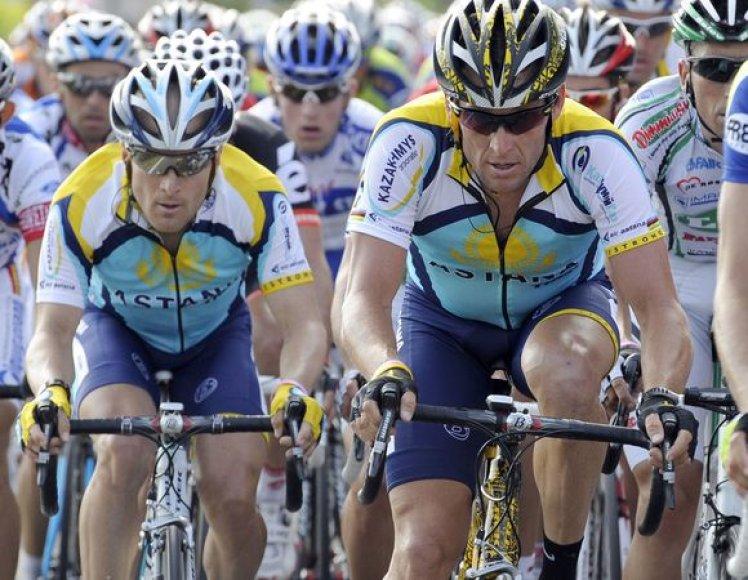 """L.Armstrongo (dešinėje) teigimu, pabaigti šį sezoną """"Astanos"""" komandai kainuotų apie 5,3 mln. svarų sterlingų (20,4 mln. Lt)."""