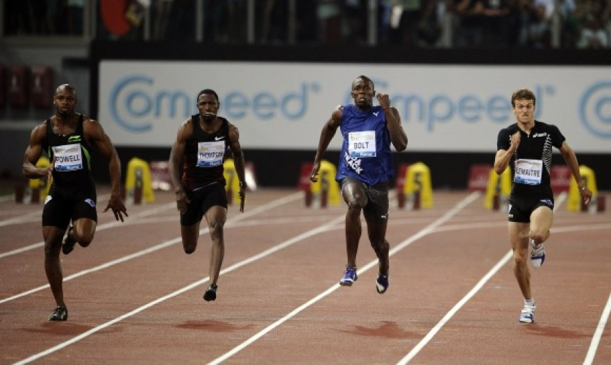 A.Powellas (iš kairės), U.Boltas (antras iš dešinės) ir Ch.Lemaitre'as (iš dešinės).