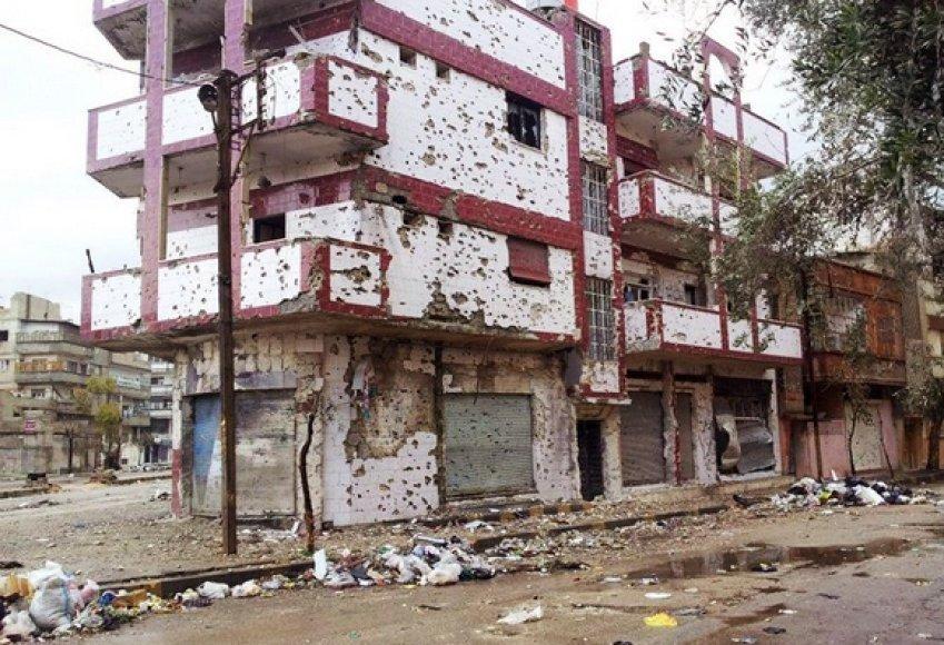 Bombardavimų apgadintas pastas Homse