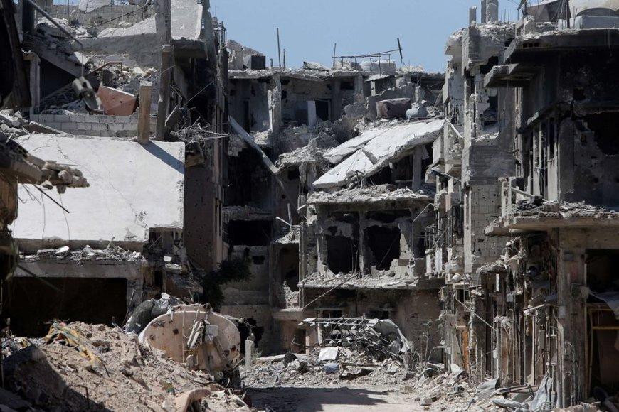 Homso mieste sugriuvę pastatai