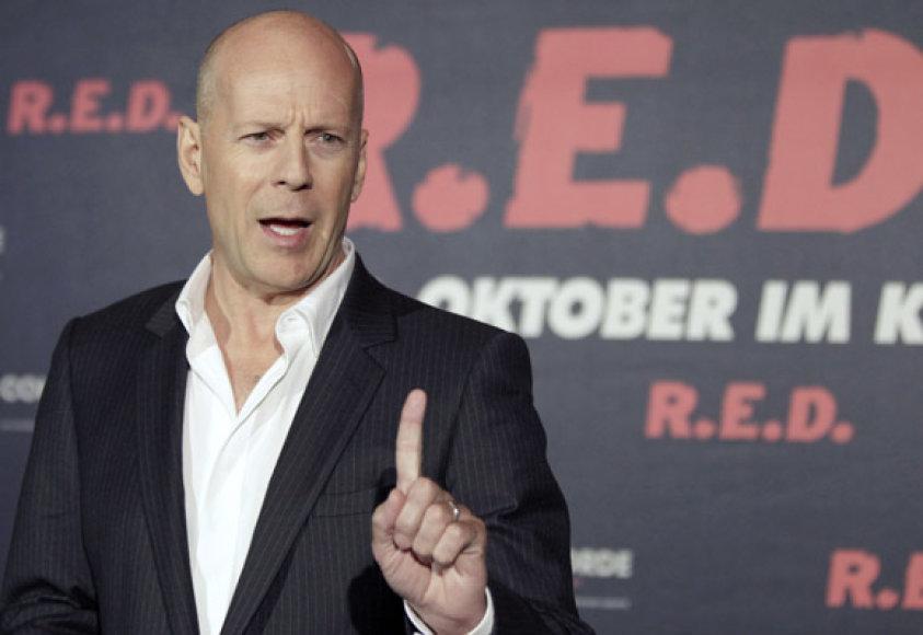 Bruce Willis pozuoja fotografams