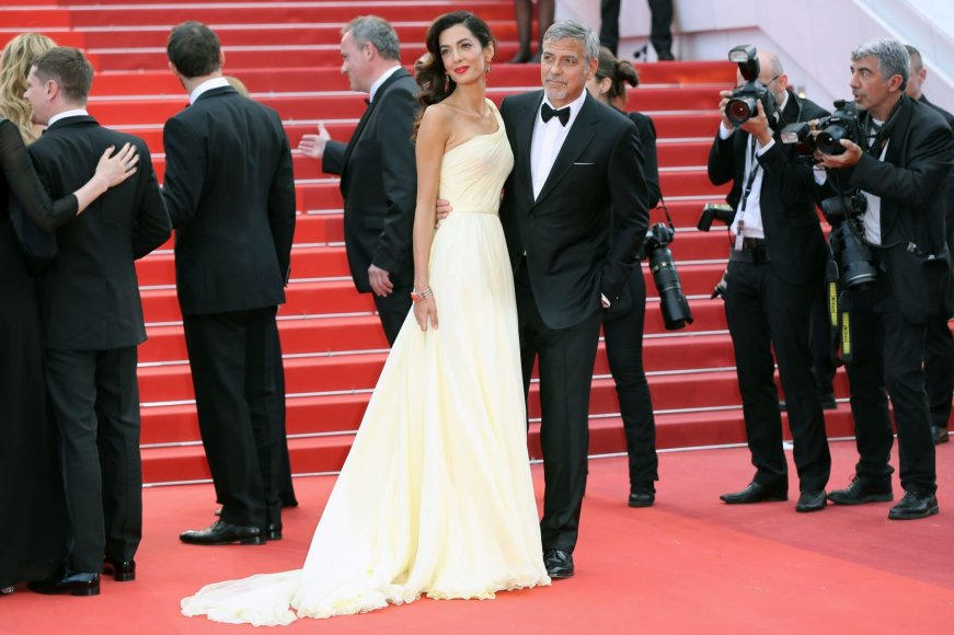 "AFP/""Scanpix"" nuotr./George'as Clooney su žmona Amal Clooney"