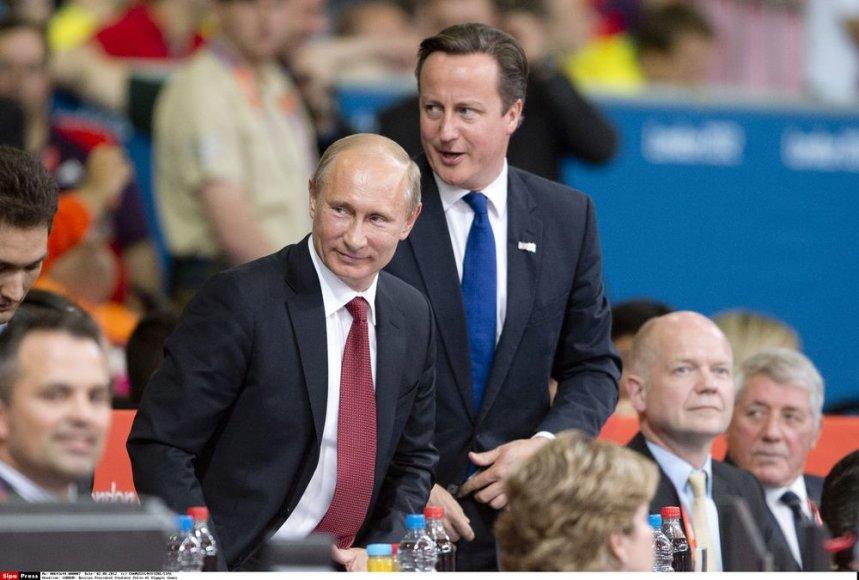 """Vladimiras Putinas stiprino """"kieto vaikino"""" įvaizdį, atvykęs stebėti dziudo turnyro Londono olimpiadoje"""