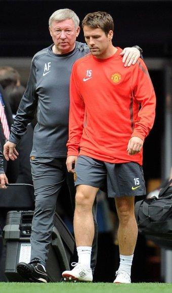 "Michaelis Owenas ir ""Manchester Unidet"" komandos treneris Alexas Fergusonas."