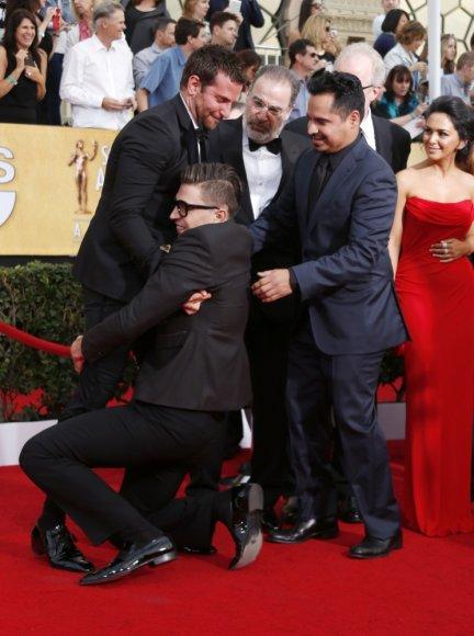 Vitalijus Sediukas parpuolęs ant žemės apkabino Bradley Cooperį