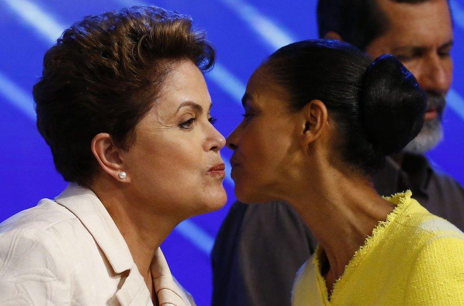 Dilma Rousseff (kairėje) ir Marina Silva sveikinasi prieš prasidedant TV debatams