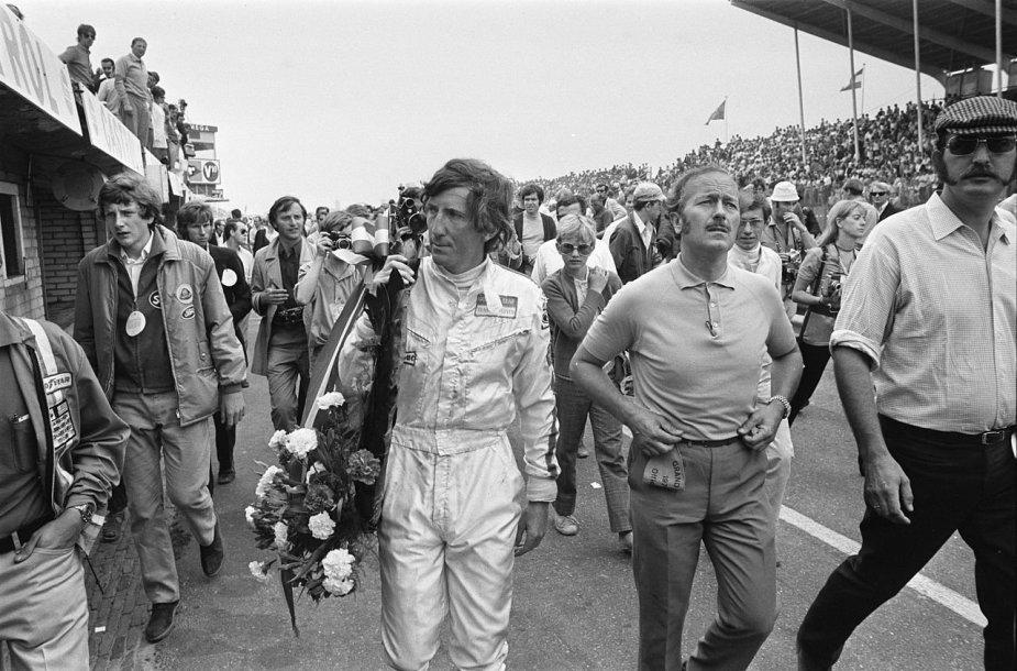 Rindtas su Lotus F1 komandos vadovu Colinu Chapmanu – šiuos vyrus siejo ne patys šilčiausi santykiai, nes Rindtas atvirai kritikavo bolidų saugumą. (Evers, Joost, Wikimedia(CC BY-SA 3.0 nl)