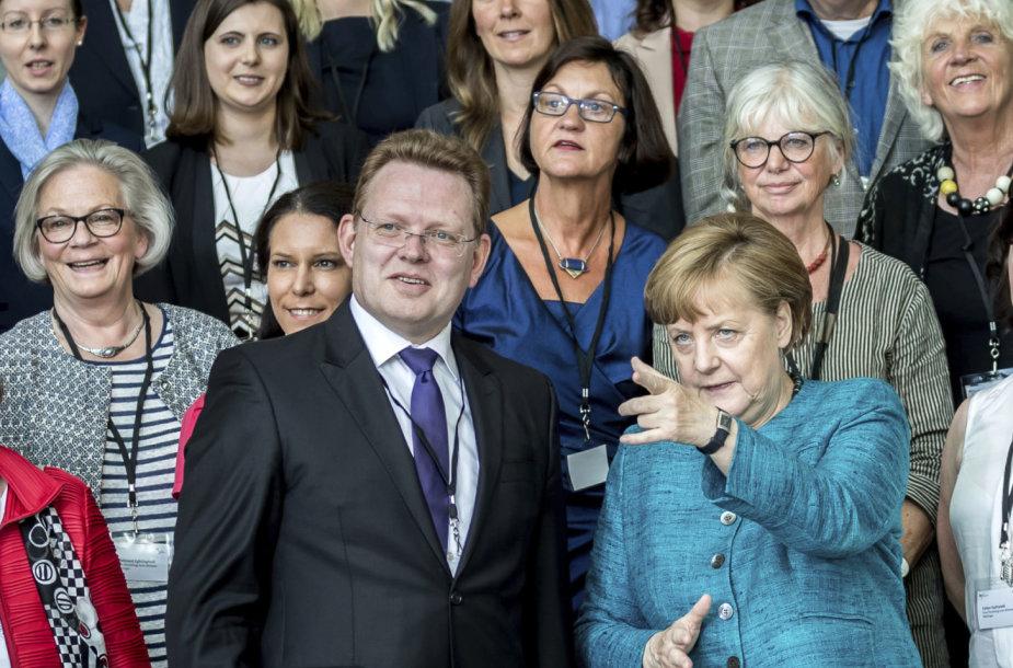 Andreas Hollsteinas ir Angela Merkel