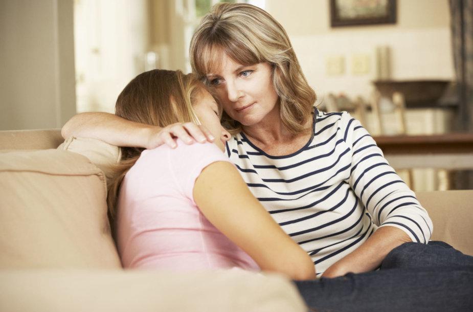 Paguoda mamos glėbyje