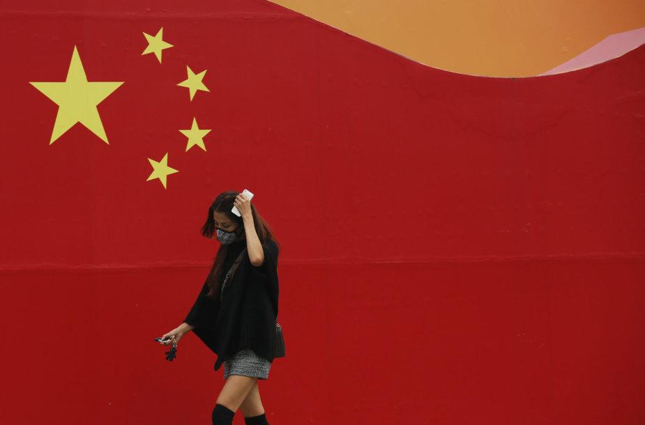 Praeivė Kinijos sostinėje Pekine