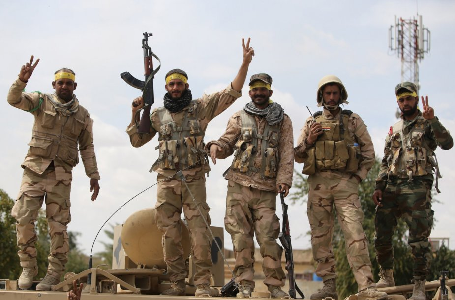 Irako pajėgos švenčia pergalę Tikrite.