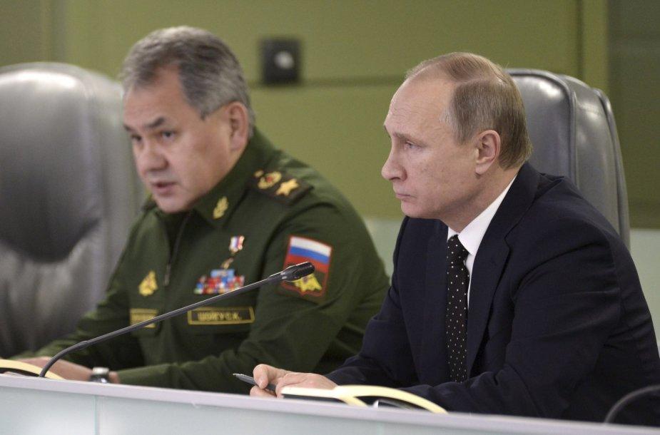 Sergejus Šoigu ir Vladimiras Putinas