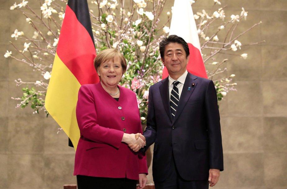 Angela Merkel ir Shinzo Abe